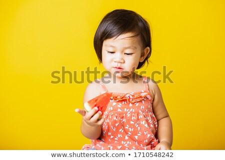 Imádnivaló kislány ázsiai származású visel piros póló Stock fotó © pressmaster
