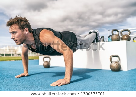 Fiatal férfiak testmozgás váll sport fitnessz egészség Stock fotó © Jasminko