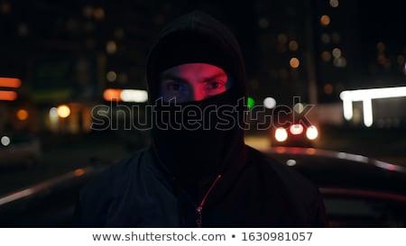Terrorist or gangster in black jacket and balaclava on head holding handgun Stock photo © pressmaster