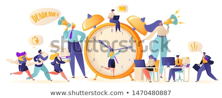 business team with papers working late at office Stock photo © dolgachov