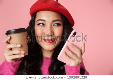 Image of young beautiful asian girl wearing beret rejoicing and  Stock photo © deandrobot