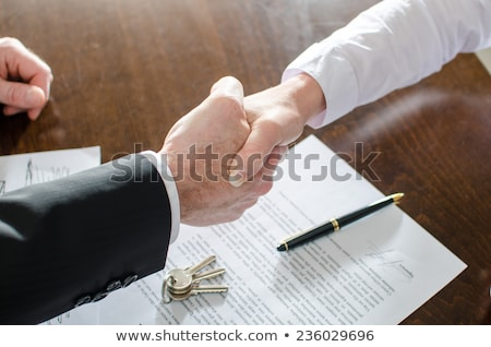 Estate agent shaking hands with customer after contract signatur Stock photo © snowing