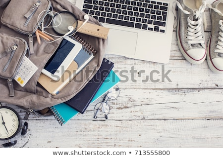 backpacking with laptop, books and pencil Stock photo © Raduntsev