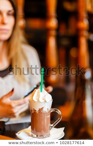 beautiful woman drinking latte macchiato coffee looking to side Stock photo © Rob_Stark