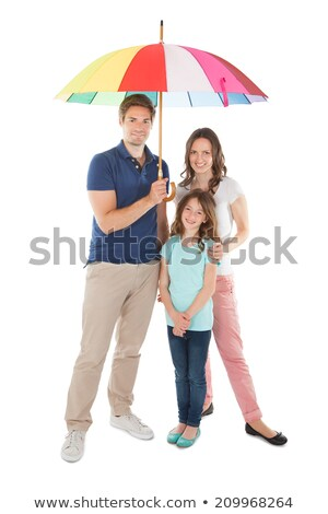 Young family sheltering under an umbrella Stock photo © photography33