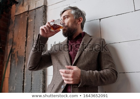 Businessman with a glass of whisky in casual clothing Stock photo © pedromonteiro