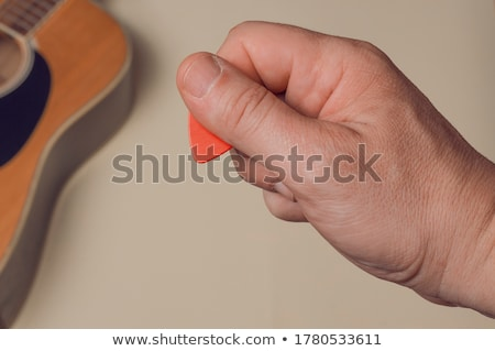 Human hand holding guitar music instrument Stock photo © ia_64