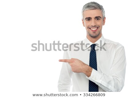 Male executive indicating towards copy space area Stock photo © stockyimages