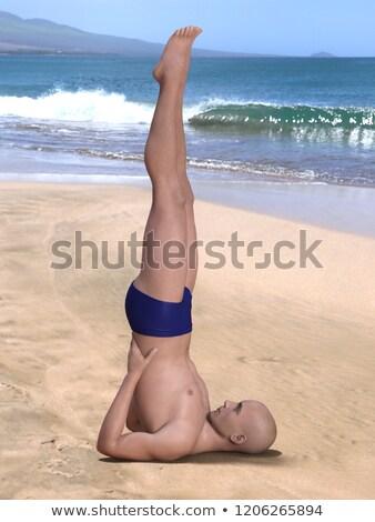 salamba sarvangasana supported shoulderstand on white sand stock photo © dolgachov