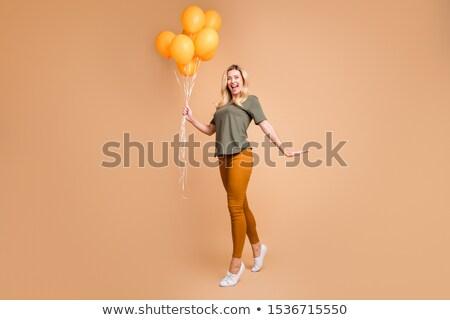 gülen · olgun · kadın · turuncu · el · vücut - stok fotoğraf © annakazimir