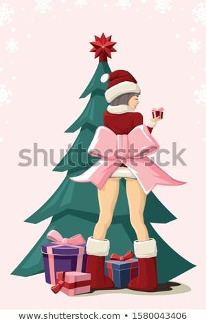 Faible Noël présente relevant chapeau coloré Photo stock © Rob_Stark