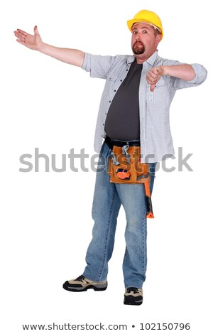 Tradesman pointing to an object and giving the thumb's down Stock photo © photography33