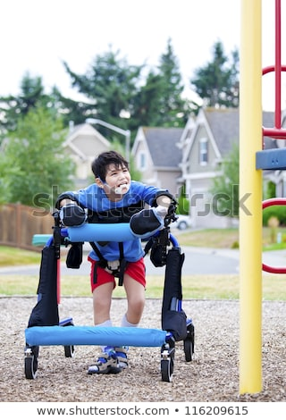 Disabled boy in walker walking up to a handicap inaccessible pla Stock photo © jarenwicklund