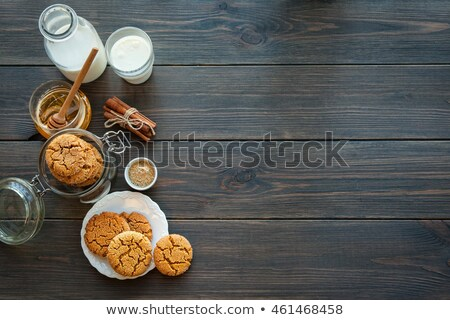 Bottle and a glass of milk with cakes Stock photo © stevanovicigor