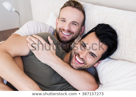 young couple asleep holding hands in bed stock photo © photography33