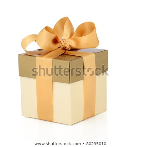 Gift box in gold duo tone with golden satin ribbon and bow isolated over white background. Stock photo © ozaiachin