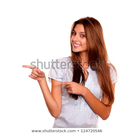 Stylish young woman looking at you pointing right Stock photo © pablocalvog