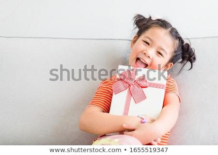 child with gift stock photo © pressmaster