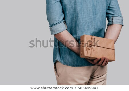 Stock photo: Rear view of man holding gift box