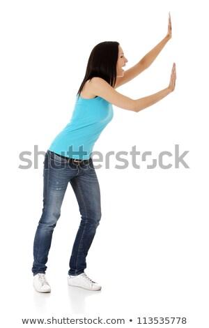 женщину · что-то · мнимый · изолированный · белый - Сток-фото © stepstock