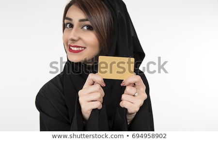 Young smiling arab showing business card in hand isolated on whi Stock photo © vlad_star