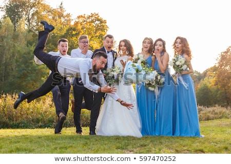 Laughing wedding couple in funny pose stock photo konrad b k konradbak 3732050 stockfresh - Pose photo mariage ...