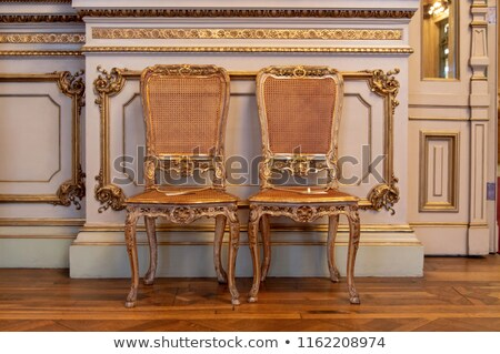 Elegant woman on an antique chair Stock photo © stryjek