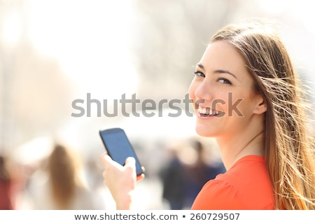 Chat by phone woman smile at camera Stock photo © vetdoctor