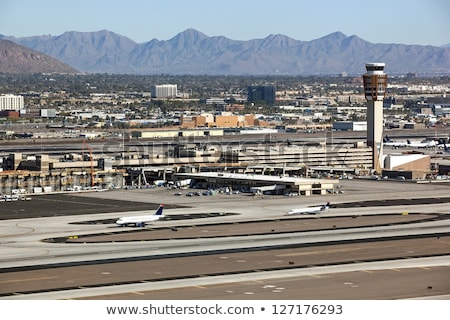 sky trains traveling on rails to phoenix sky harbor airport stock photo © epstock