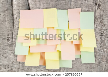 wooden wall with post it papers Stock photo © compuinfoto