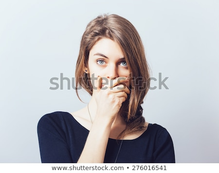 young woman with hand over her mouth stock photo © bmonteny