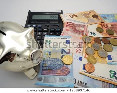 десять евро законопроект Piggy Bank калькулятор деньги Сток-фото © diabluses