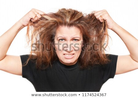 Angry woman tearing her hair in frustration Stock photo © dash