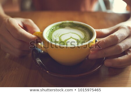hands hold hot drink of matcha green tea latte stock photo © nalinratphi
