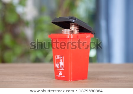 Stock photo: dollars in red garbage can
