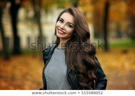 smiling young woman in gray pullover and jeans Stock photo © dolgachov