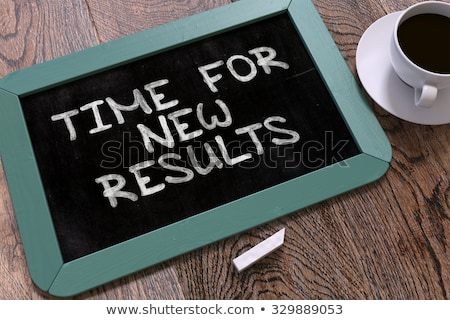 Time for New Results. Motivation Quote on a Blackboard. Stock photo © tashatuvango