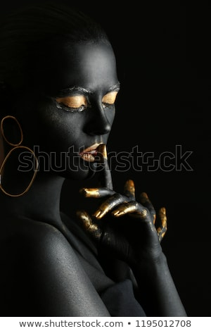 Portrait of a woman with gold makeup Stock photo © gromovataya