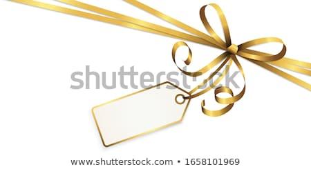 gold ribbon with bow isolated on white eps 10 stock photo © beholdereye