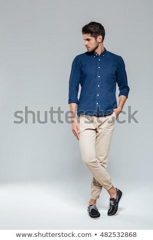 Portré boldog férfi lábak keresztbe visel szemüveg Stock fotó © feedough