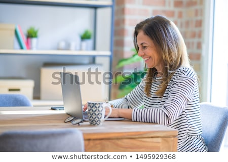 Woman with laptop computer. Stock photo © iofoto