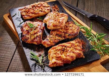 Marinato carne di maiale cotoletta spinaci foglie alimentare Foto d'archivio © Digifoodstock