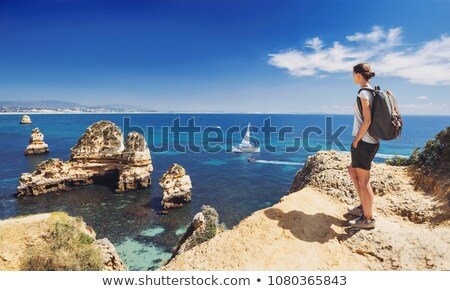 Female tourist walking on rocks Stock photo © dash