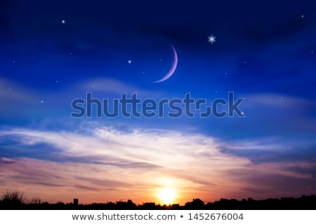moon crescent and pastel colors sunset sky stock photo © juhku
