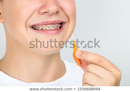 Mosolyog fiatal férfi fogorvos tart fogkefe Stock fotó © deandrobot