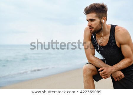 Uitgeput man pauze jogging strand Stockfoto © wavebreak_media