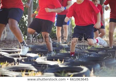 Entraîneur enfants démarrage camp ciel Photo stock © wavebreak_media