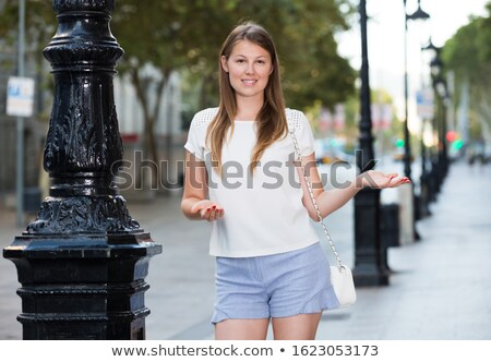 smiling woman in dress walking and welcoming you stock photo © feedough