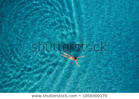 aerial view of woman swimming in the sea stock photo © denbelitsky