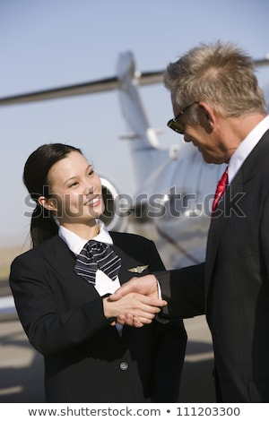 Flight personnel shaking hands Stock photo © IS2